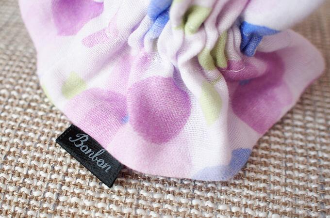 イヤーシュシュ フラワーシャワーシリーズ(紫)ボンボン ロゴ